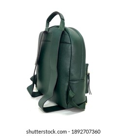 Leather backpack in dark green colour captured on white background