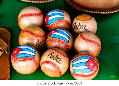Leather baseball balls and Cuban flag on the market stall
