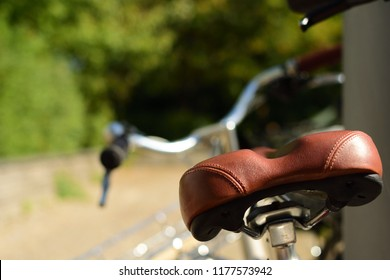 Leather bicycle saddle, summer in the city