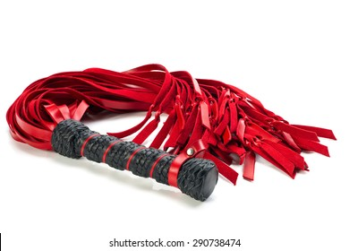 Leather black and red whip isolated on a white background