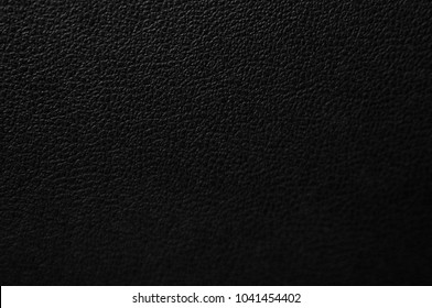 Leather black texture.Black dark leather background.