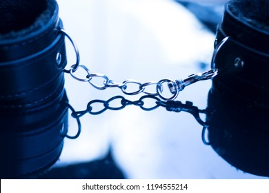 Leather bondage s&m handcuff restraints for kinky adult sexy domination games.