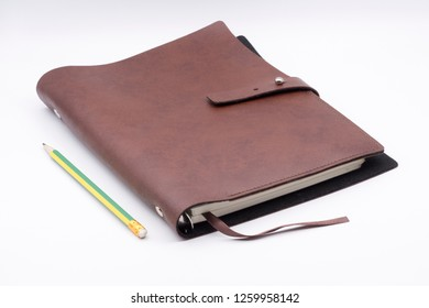 Leather book and pencil