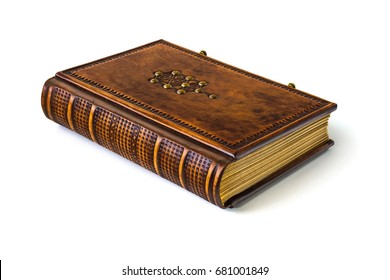 Leather book with Tree of Life symbol laying to the table isolated