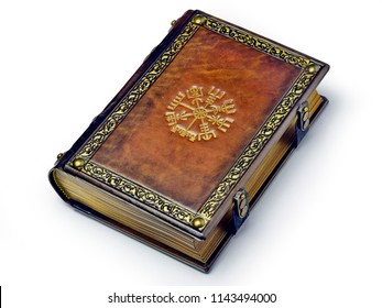 Leather book with the Vegvisir, ancient Icelandic magical symbol. The book is captured from the right side while lay down to the table