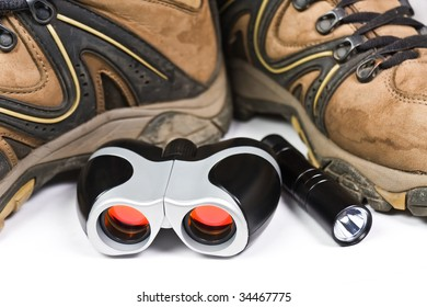 Leather boots with binoculars and flashlight