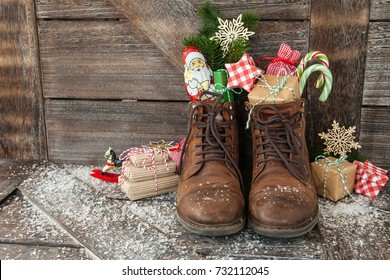 Leather boots with christmas treats and presents