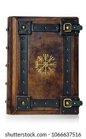 """Leather bound book with gilded ancient Viking symbol - front view of the front cover. English translation of the symbol is:  """"That Which Shows the Way"""""""