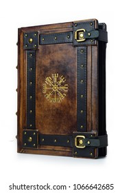 """Leather bound book with gilded ancient Viking symbol - view from the right side of the front cover. English translation of the symbol is:  """"That Which Shows the Way"""""""