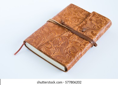 A leather bound journal is closed.