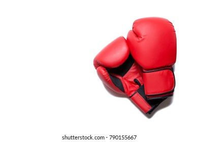 Leather box equipment for fight and training. Pair of boxing gloves lying on each other. Combat and fight concept. Boxing gloves in red color isolated on white background
