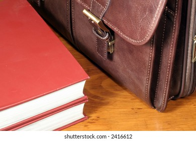 Leather Briefcase and Red Books
