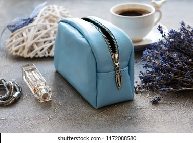 Leather cosmetic bag with accessories on a stone background
