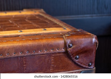 Leather covered corner of old steamer trunk