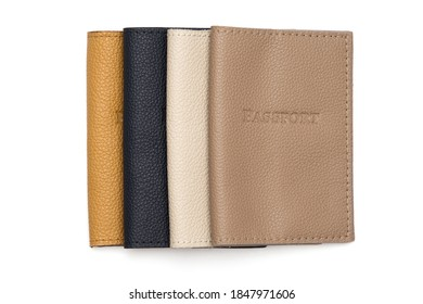 Leather covers for passport, handcrafted work. Brown, white, yellow, beige colors on a white background