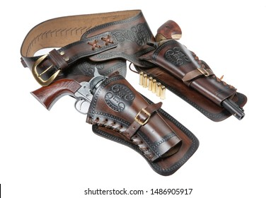 Leather cowboy holster and revolver on an isolated studio background