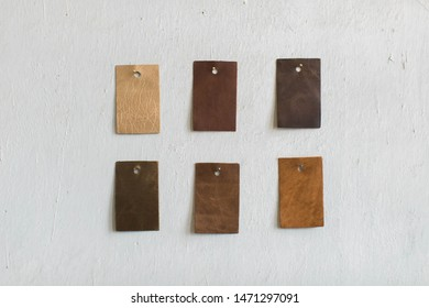 Leather Cowhide Swatches hanging on wall, copy space, purse and bag leather samples