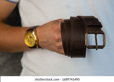 leather craft. Handmade leather belt. ashionable men's brown belt made of genuine leather with a light metal buckle. Genuine leather, handmade