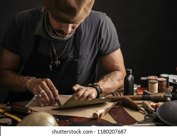 Leather craftsman working with natural leather. Shoemaker master at work in local workshop. Handmade concept. Male cobbler creating modern fashionable shoes. Shoe making Small business Concept