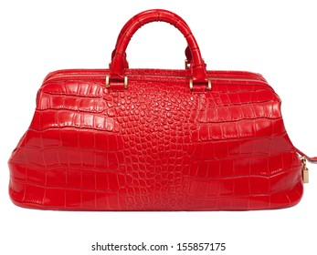 Leather female handbag red color, accessory on a white background nobody.