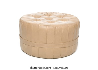 Leather footstool on white background