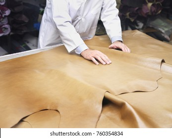 leather goods manufacturer showing his leather