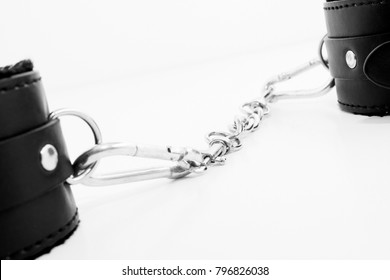 Leather handcuffs isolated on a white background