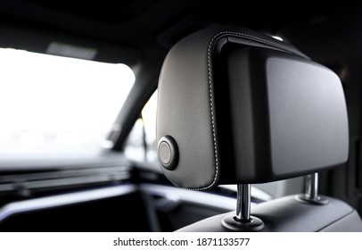 Leather headrest in the car. Inside the car.