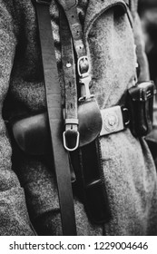 Leather holster for a pistol on the uniform of a German soldier of the Second World War. Black and white shot