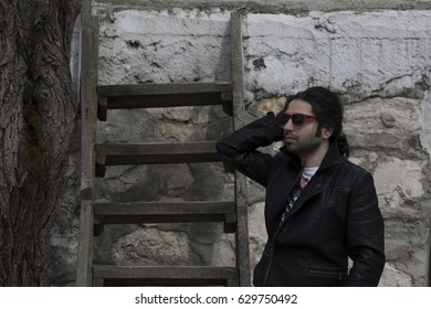 Leather jacket and long haired male model