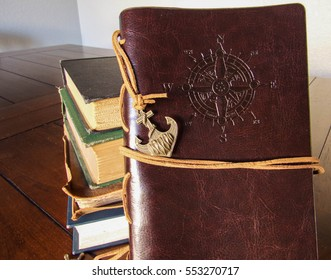 Leather journal with a compass