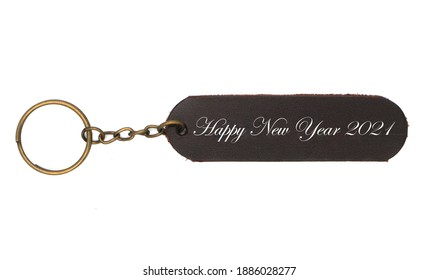 Leather keychain with Happy new yaer 2021 word isolated on white background. Brown Color , Happy new year label accessory chain with key