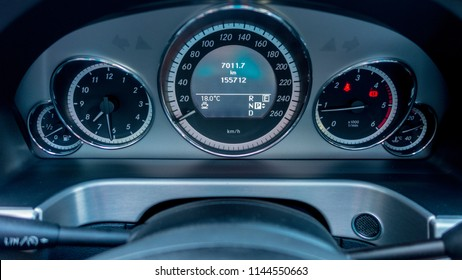 Leather luxurious steering wheel with F1 paddle automatic gear shift gears, volume buttons, part of intrument cluster and air vents. Driver view, bblack leather.