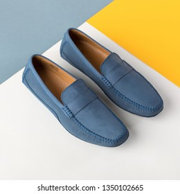 Leather men's loafers blue top view. Colored background with geometric lines