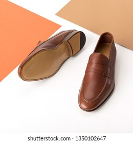 Leather men's shoes brown, top view. Colored background with geometric lines