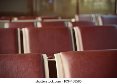 Leather & metallic stack of chairs of a waiting zone isolated object photograph