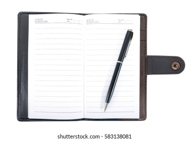Leather notebook opened with pen isolated on white background.Leather notebook with pen isolated