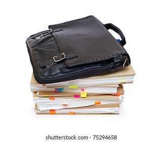 Leather portfolio lying on a pack of documents