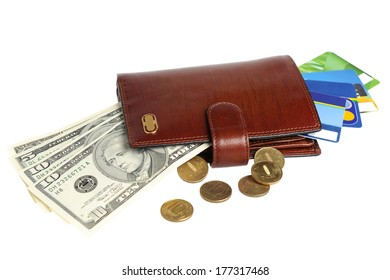 Leather purse with banknotes, coins and credit cards isolated on white background