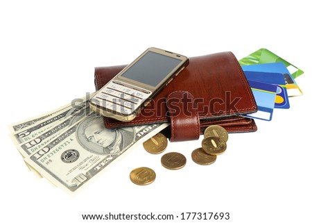 Leather purse with banknotes, coins, credit cards and mobile phone isolated on white background
