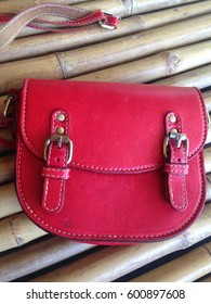 Leather Red hand bag on bamboo wood