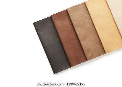 Leather samples of different colors for interior design on white background