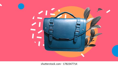 Leather Satchel Bag with plants isolated on abstract colorful background.Cambridge Style Satchel Bag. Fashion handbag. Composition of clothes. Fun party fashion summer mood. Banner sale
