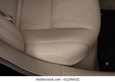 Leather seat with stich. Car interior detail.