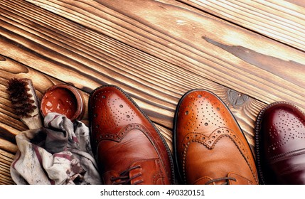 leather shoes brogues with shoe maintenance set.top view