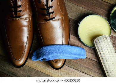 Leather Shoes with Maintenance Set on wood background, Men fashion