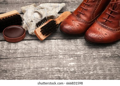 Leather shoes on table with brush,dirty cloth and polish cream