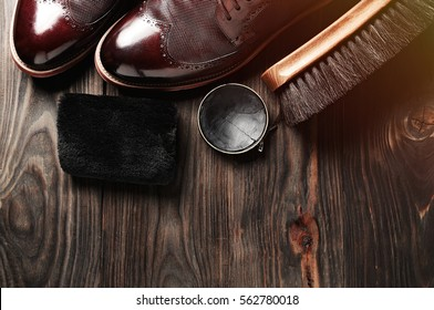 leather shoes on table with polishing equipment. shoes shine, fashion, handmade. Wax. Wooden background