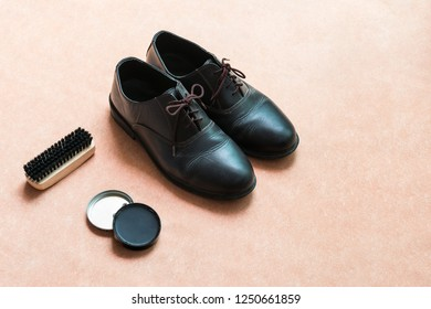 Leather shoes and shoe maintenance set with copy-space for text. Shoes care concept.