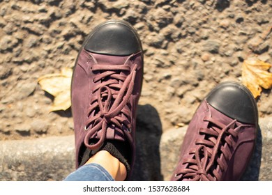 leather shoes for women on their feet on the road in the afternoon on the street view from top to bottom